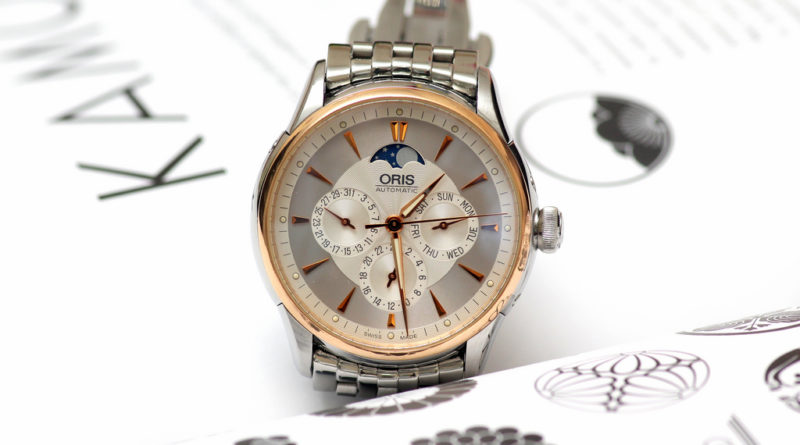 Oris Artelier Complication. Обзор часов с золотым безелем